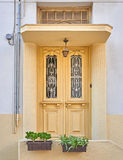 Greece, vintage door and flowerpots Royalty Free Stock Photos