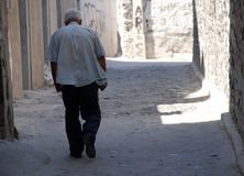 Greece, walking old man Stock Photo