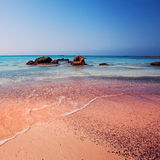 Greece. The Wave of the Sea on the Pink Sand. Crete, Greece. The Wave of the Sea on the Pink Sand on Beautiful Beach. Pink Sand Beach of Famous Crete Island Stock Photos