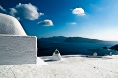 Greece in white and blue. View on the sea and a typical house in the steep coast on top of the caldera in Santorini, Greece, all in the greek national colors Royalty Free Stock Image
