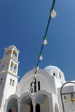 Greece. White church against blue sky. Royalty Free Stock Images