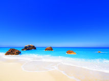 Greece. Wild beautiful natural archipelago beach with rocks in water. Island Lefkada, Leucas or Leucadia, Levkas, Lefkas, ionian sea, Greece Stock Image