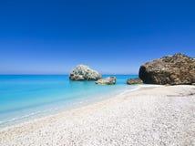 Greece. Wild beautiful natural archipelago beach with rocks in water. Island Lefkada, Leucas or Leucadia, Levkas, Lefkas, ionian sea, Greece Royalty Free Stock Photo