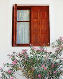 Greece, window and oleander flowers Royalty Free Stock Images