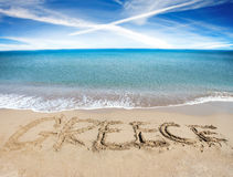 Greece written in golden sand Stock Image