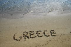 Greece written in the Sand Stock Photo