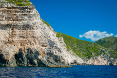 Greece, Zakynthos, August 2016. Rocks, caves and blue water. Blue cave under rocks Royalty Free Stock Image