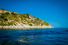 Greece, Zakynthos, August 2016. Rocks, caves and blue water. Cliffs landscape Royalty Free Stock Photography
