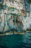 Greece, Zakynthos, August 2016. Rocks, caves and blue water. Cliffs landscape, blue cave Stock Photos