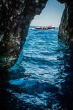 Greece, Zakynthos, August 2016. Rocks, caves and blue water. Cliffs landscape, blue cave, boat catched between rocks Royalty Free Stock Photography