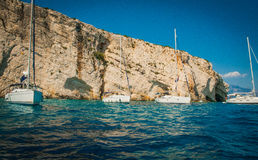 Greece, Zakynthos, August 2016. Rocks, caves and blue water. Cliffs landscape, blue cave, boats on water Stock Photography