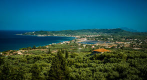 Greece, Zakynthos, August 2016. Rocks, caves and blue water. View from observation point to panorama of island, bay and road. Boats above Royalty Free Stock Image