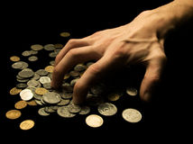 Greed. Financial concept - hand grabbing coins Stock Photography
