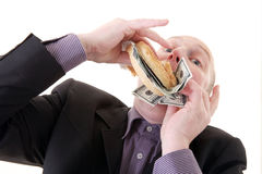 Greed avarice consuming dollars. Greed, businessman eating money. man eat dollars in display of avarice isolated on white royalty free stock images