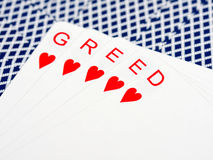 Greed in casino. Greed hand of cards in casino stock images