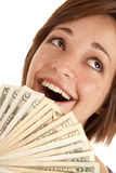 Greed close up face. A woman laughing at how much money she has in her hands Royalty Free Stock Photo