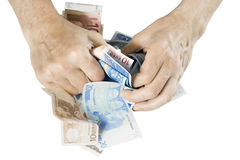 Greed money concept. Greedy hands hide money. The greed concept. Isolated on white. With clipping patch stock photography