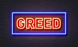 Greed neon sign on brick wall background. Greed neon sign on brick wall background Royalty Free Stock Image
