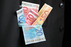 Greed. Put money in your pocket Royalty Free Stock Photography