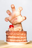 Greed for sweets concept with hand and chocolate cake. Concept stock photo