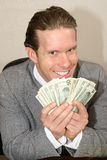 Greedy. Businessman with stack of money Royalty Free Stock Images