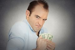 Greedy banker executive CEO boss, holding dollar banknotes Stock Image