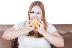 Greedy blonde woman eats hamburger Royalty Free Stock Image