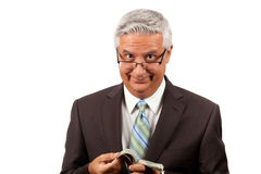 Greedy business man Stock Photography