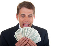 Greedy Business Man. Greedy middle aged successful businessman licking his hard earned money Royalty Free Stock Images
