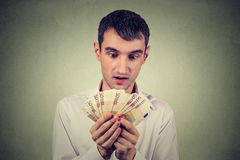 Greedy business man counting money Royalty Free Stock Photos