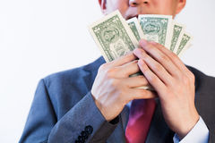 Greedy Business man showing off his money. On white background Royalty Free Stock Photo