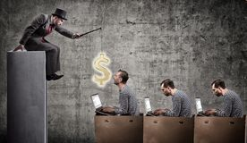 A greedy businessman motivates office workers with a salary. Office slavery concept Stock Photography