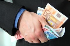 Greedy businessman Royalty Free Stock Image