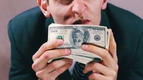 Greedy Businessman sniffing money.