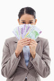A greedy businesswoman holding bank notes Royalty Free Stock Images