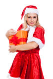 Greedy Christmas woman with present Royalty Free Stock Image