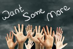 Greedy concept. Many waving hands on chalkboard background with want some more text. Greedy concept Stock Photography