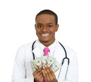 Greedy doctor Stock Photography