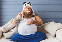 Greedy fat man eating sweet food Royalty Free Stock Image