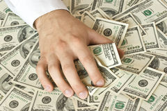 Greedy hand grabs money Stock Photography