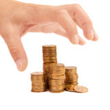 Greedy hand stretches to the coins Royalty Free Stock Image