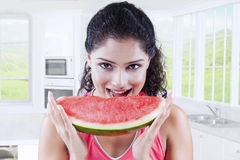 Greedy Indian woman eating watermelon Royalty Free Stock Images
