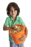 Greedy little boy with popcorn Royalty Free Stock Photos