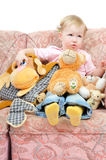 Greedy little girl with a lit of toys Royalty Free Stock Photos