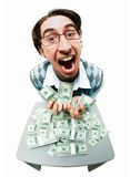 Greedy man. Portrait of rich man raking in American dollars with satisfied expression royalty free stock photo