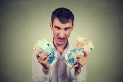 Greedy man with euro banknotes Royalty Free Stock Image
