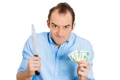 Greedy man ready to kill for money Royalty Free Stock Photo
