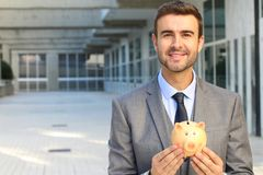 Greedy man saving his money.  stock photography