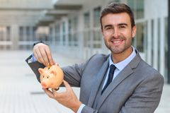 Greedy man saving his money.  Stock Images