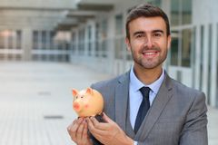 Greedy man saving his money.  Royalty Free Stock Images